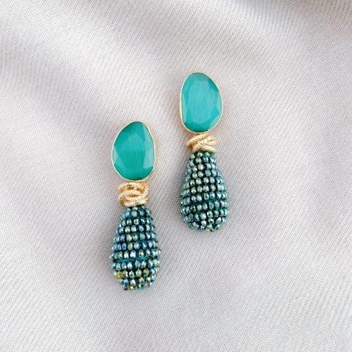 Blauw/groen kristallen en cat's eye oorbellen
