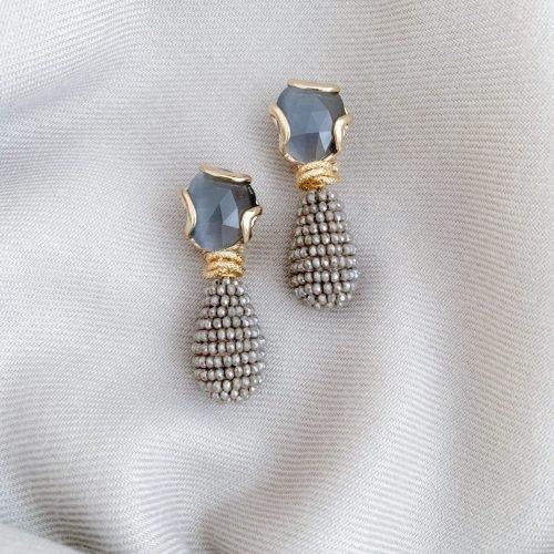Grijs/taupe kristallen en grijze cat's eye oorbellen